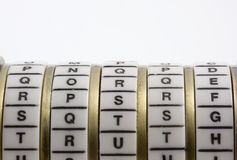 Password, keyword or combination - truth. Cryptex. Password or keyword - truth. A combination puzzle box (cryptex) with letter rings on a white background; copy Stock Photo