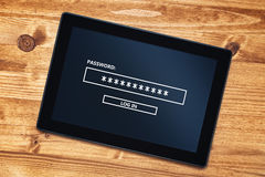 Password protected digital tablet computer on office desk, top v Royalty Free Stock Photos
