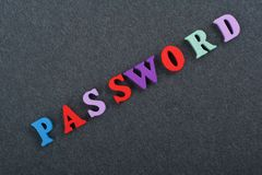 PASSWORD word on black board background composed from colorful abc alphabet block wooden letters, copy space for ad text Stock Image