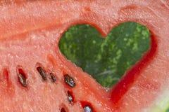 Pastèque avec des fruits d'amour de forme de coeur Photos libres de droits