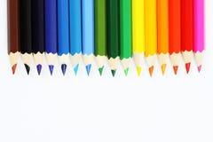 Pastéis coloridos em seguido no fundo branco Imagem de Stock