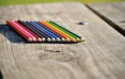 Pastéis coloridos na prancha de madeira Copie o espaço Imagens de Stock Royalty Free