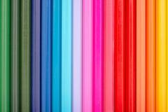 Pastéis da coloração arranjados na linha do arco-íris Imagens de Stock