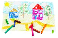 Pastéis de cera e um desenho das crianças. Foto de Stock Royalty Free