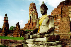 Past capitol city of thailand. Seated budda amongst ruins Royalty Free Stock Photos