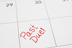 Past due. Closeup of a calendar with Past Due text Stock Images