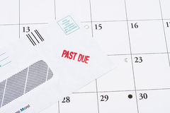 Past Due Bill. A past due bill sitting on a calendar, paying your bills on time Stock Photography