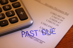 Past due payment. Past due stamp on a statement with a calculator sitting aside Royalty Free Stock Photos