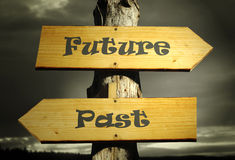 Past and Future. Two directional arrows that indicate the past and the future with a dramatic sky Royalty Free Stock Photo