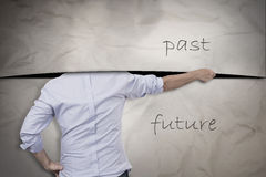 Past and future. Concept of man cutting with the past but is afraid of the future Royalty Free Stock Photo