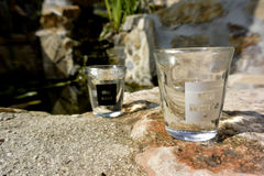 Past and future Shot glasses.. black and white Royalty Free Stock Image