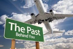 The Past Green Road Sign and Airplane Above Stock Photography
