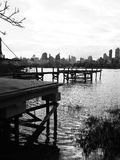 Past meets present. View of old docks overlooking new York city skyline Royalty Free Stock Photography