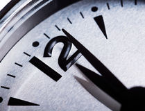 Past midnight clock. Closeup of analog clock with the time shortly after midnight or lunch Stock Photography