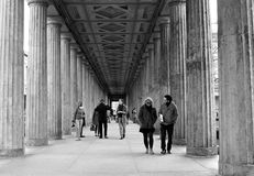 Past & Present. People walking through Colonnades square of Museum Island, Berlin, Germany April 2015. The Museum Island has been included in the list of UNESCO Royalty Free Stock Image