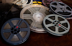 Past time movie symbol, home entertainment evocative objects. Heap of aged super 8 mm movie reels, vintage colors selective focus detail Stock Photography