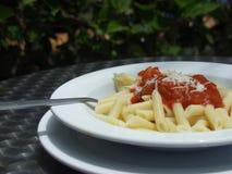 Pasta. Macaroni whit tomato sauce close up royalty free stock image