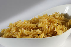 Pasta. See a portion of pasta in a white dish on white background Royalty Free Stock Photo