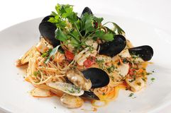 Pasta. Italy seafood noodles on white dish Stock Images