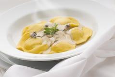Pasta. Fresh pasta stuffed with mushroom sauce Stock Photo