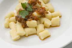 Pasta. Gnocchi  bolognese sauce plate and herbs Stock Photos