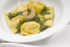 Pasta. Shrimp stuffed pasta with basil sauce Stock Image