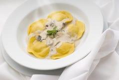 Pasta. Fresh pasta stuffed with mushroom sauce Stock Photos