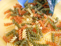 Pasta. Pasta  multi colored on the yellow background Stock Photography