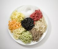 Pasta. Many various kinds of paste on plates, on a white background Royalty Free Stock Photo