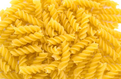 Pasta. Not cooked pasta twisted background Stock Photos
