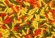Pasta. Closeup of raw multicolour pasta, food background Royalty Free Stock Images