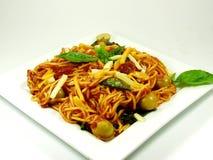 Pasta. A platter whit fresh pasta, spaghetti whit tomato sauce and tuna Stock Photos