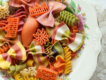 Pasta. Closeup of multicolored uncooked pasta on a fancy plate Royalty Free Stock Image