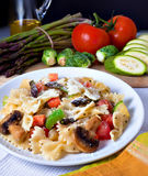 Pasta. Farfalle pasta with organic vegetables with fresh vegetables Stock Image