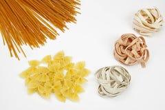 Pasta. Three different kinds of pasta - spaghetti, farfalle, tagliatelle Royalty Free Stock Photography