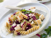 Pasta. Fresh fusilli pasta with beet pesto and cheese. Selective focus Stock Photography
