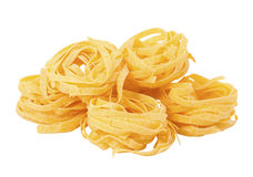 Pasta. Raw pasta. Isolated on wlthe Stock Images