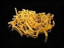 Pasta. Uncooked pasta on black background Stock Image