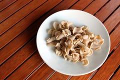 Pasta. Unprepared pasta on a white plate Stock Photos