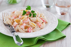 Pasta. With cream sauce and crawfish, selective focus Stock Image