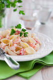 Pasta. With cream sauce and crawfish, selective focus Stock Photography