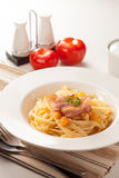Pasta. Cook with bacon and tomato Stock Images
