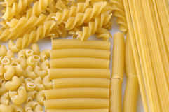 Pasta. Uncooked pasta on white background Stock Images