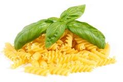 Pasta. Pile of pasta fusilli isolated on white background Stock Photography