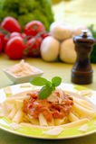 Pasta. Healthy pasta garnished with parmezan, pepper and bazil Stock Photo
