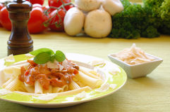 Pasta. Healthy pasta garnished with parmesan, pepper and basil Royalty Free Stock Photography
