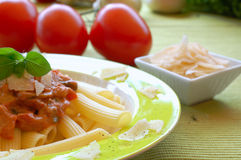 Pasta. Healthy pasta garnished with parmesan, pepper and basil stock photography