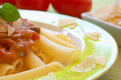 Pasta. Healthy pasta garnished with parmesan, pepper and basil Royalty Free Stock Photos
