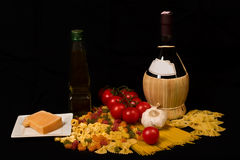 Pasta. Varieties of pasta, wine, olive oil, cheese, tomatoes and garlic Stock Photography