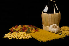 Pasta. Varieties of pasta, wine and garlic Stock Image